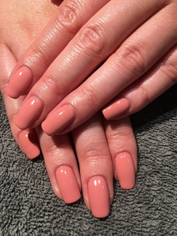 Flawless coral manicure with Reigate gel nails