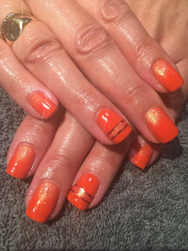 Orange vibrant nail colours with gel nails