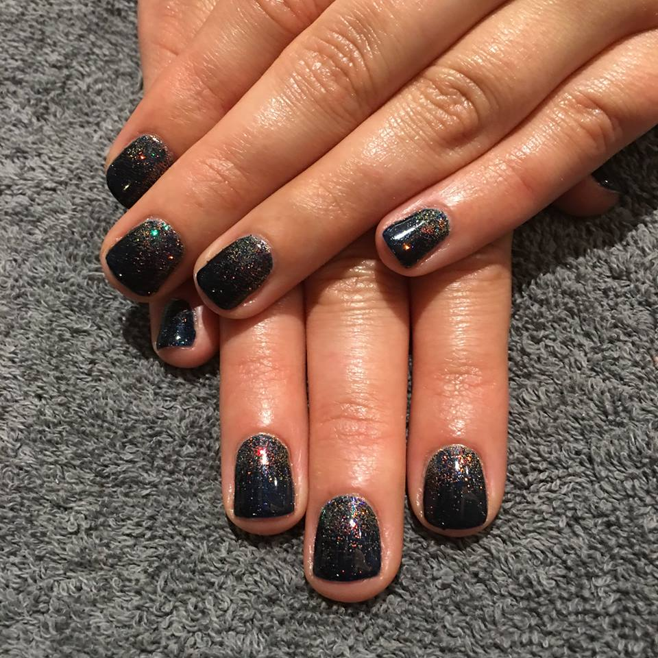 Gel nails with glitter nail art