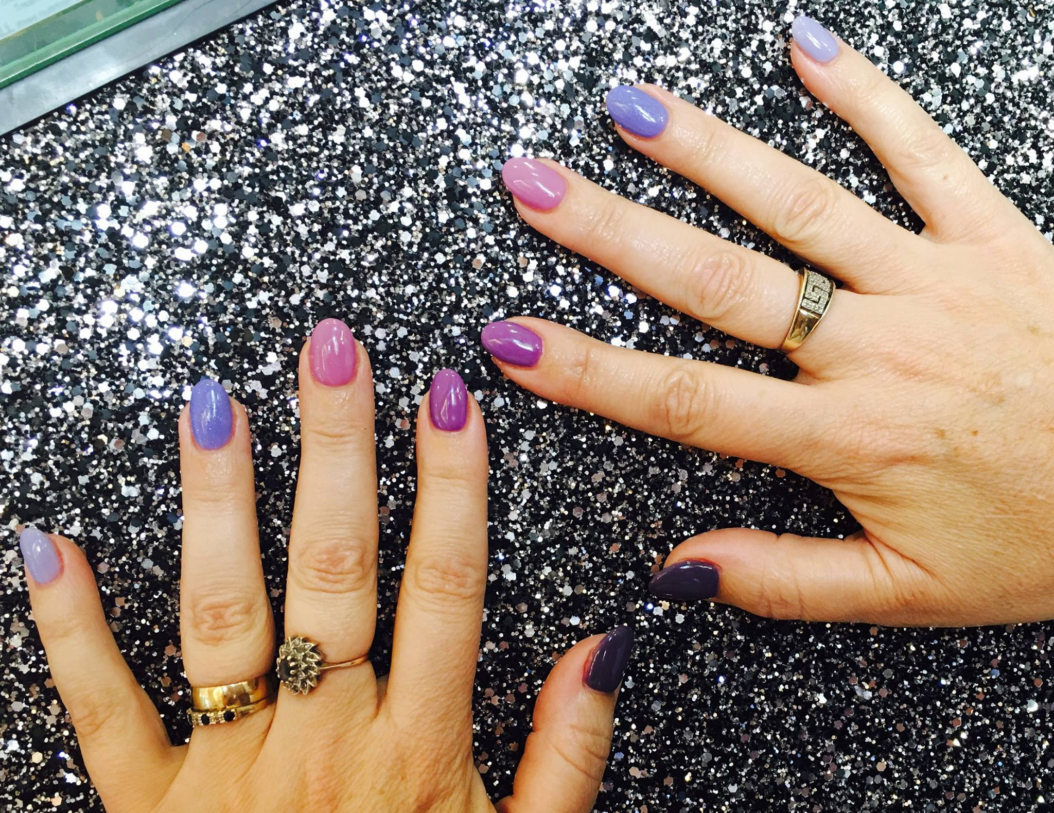 Purple lilac multi-coloured gel nails at surrey nail salon